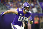 FILE - In this Oct. 13, 2019, file photo, Minnesota Vikings tight end Kyle Rudolph runs up field during the first half of an NFL football game against the Philadelphia Eagles, in Minneapolis. In his ninth season with the Vikings, Kyle Rudolph realizes he doesn't have many more of these chances to win a championship. The Vikings start the playoffs at New Orleans on Sunday, Jan. 5, 2020.(AP Photo/Bruce Kluckhohn, File)