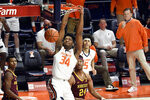 Illinois center Jermaine Hamlin (34) dunks the ball against Minnesota in the second half of an NCAA college basketball game Tuesday, Dec. 15, 2020, in Champaign, Ill. (AP Photo/Holly Hart)