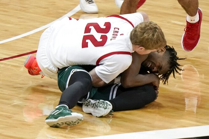 Wisconsin's Steven Crowl and Wisconsin-Green Bay's PJ Pipes go after a loose ball during the second half of an NCAA college basketball game Tuesday, Dec. 1, 2020, in Madison, Wis. (AP Photo/Morry Gash)