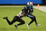 Carolina Panthers wide receiver Robby Anderson is tackled by Atlanta Falcons cornerback A.J. Terrell during the first half of an NFL football game Thursday, Oct. 29, 2020, in Charlotte, N.C. (AP Photo/Mike McCarn)