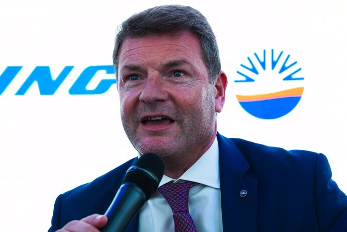 SunExpress CEO Jens Bischof speaks at a news conference at the Dubai Airshow in Dubai, United Arab Emirates, Monday, Nov. 18, 2019. The Turkish-German airline SunExpress announced Monday it will be buying 10 of the troubled Boeing 737-8 Max jets, grounded globally after crashes, in a deal worth $1.2 billion. (AP Photo/Jon Gambrell)