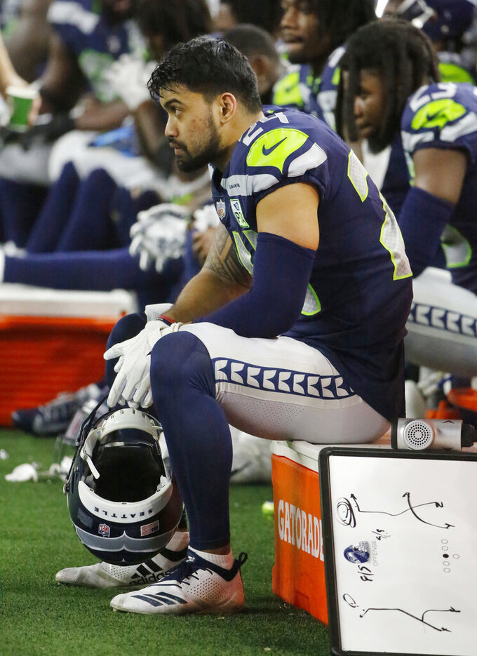 Seattle Seahawks safety Shalom Luani (24) sits on the bench late during the second half of the NFC wild-card NFL football game against the Dallas Cowboys in Arlington, Texas, Saturday, Jan. 5, 2019. The Dallas Cowboys won 24-22. (AP Photo/Michael Ainsworth)