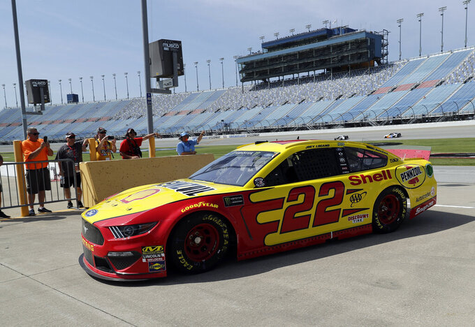 Joey Logano drives to the garage during a practice for the NASCAR Sprint Cup Series auto race at Chicagoland Speedway in Joliet, Ill., Saturday, June 29, 2018. (AP Photo/Nam Y. Huh)