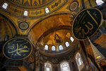 A gold-colored mosaic, centre, that depicts The Virgin Mary and Jesus is seen inside the Byzantine-era Hagia Sophia, in the historic Sultanahmet district of Istanbul, Friday, Oct. 15, 2010. Turkish President Recep Tayyip Erdogan is scheduled to join hundreds of worshipers Friday, July 24, 2020, for the first Muslim prayers at the Hagia Sophia in 86 years, weeks after a controversial high court ruling paved the way for the landmark monument to be turned back into a mosque. The mosaics will be covered up with curtains during the prayers, officials have said. (AP Photo/Emrah Gurel)
