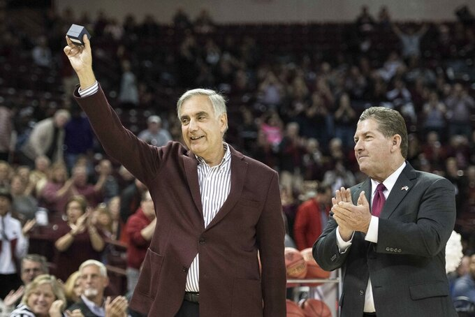 FILE - In this Nov. 10, 2017 file photo, University of South Carolina president Harris Pastides, left, and athletic director Ray Tanner show off a 2017 women's basketball SEC championship ring before an NCAA college basketball game in Columbia, S.C. Pastides was named interim president of the University of South Carolina on Friday, May 21, 2021, after President Bob Caslen resigned on May 13 following a plagiarism scandal. (AP Photo/Sean Rayford, File)
