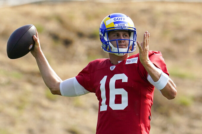 Los Angeles Rams quarterback Jared Goff throws during NFL football training camp, Tuesday, Aug. 18, 2020, in Thousand Oaks, Calif. (AP Photo/Marcio Jose Sanchez)