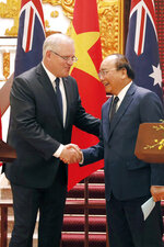 Australian Prime Minister Scott Morrison, left, and his Vietnamese counterpart Nguyen Xuan Phuc shake hands during a press briefing at the Government Office in Hanoi, Vietnam, Friday, Aug. 23, 2019. (AP Photo/Duc Thanh)