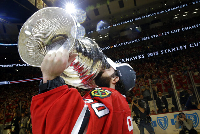 FILE - In this June 15, 2015, file photo, Chicago Blackhawks' goalie Corey Crawford kisses the Stanley Cup Trophy after defeating the Tampa Bay Lightning in Game 6 of the NHL hockey Stanley Cup Final series in Chicago. The past few weeks have seen several recent Stanley Cup winners get rid of members of their championship core. The Blackhawks moved on from Corey Crawford, the Washington Capitals did the same with Braden Holtby, the Pittsburgh Penguins traded fellow goalie Matt Murray and forward Patric Hornqvist and the St. Louis Blues signing Torey Krug means captain Alex Pietrangelo will sign elsewhere.  (AP Photo/Nam Y. Huh, File)