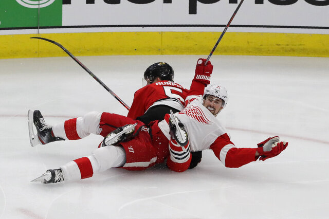 Detroit Red Wings center Dylan Larkin (71) reacts after he was checking by Chicago Blackhawks defenseman Connor Murphy (5) during the first period of an NHL hockey game in Chicago, Sunday, Jan. 5, 2020. (AP Photo/Nam Y. Huh)