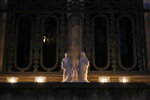 Candles are set up on a balcony in Versailles, Wednesday, March 25, 2020. France's bishops called for Catholics and non-Catholics alike to take part in Wednesday's candle-lighting, in a shared