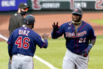 Minnesota Twins' Miguel Sano (22) is congratulated by third base coach Tony Diaz (46) while rounding the bases after hitting a two-run home run during the seventh inning in the first game of a baseball doubleheader against the St. Louis Cardinals Tuesday, Sept. 8, 2020, in St. Louis. (AP Photo/Jeff Roberson)