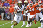 FILE - Wake Forest running back Christian Beal-Smith rushes out of the backfield during the first half of an NCAA college football game against Clemson in Clemson, S.C., in this Saturday, Nov. 16, 2019, file photo. The Demon Deacons return nine starters on both offense and defense. (AP Photo/Richard Shiro, File)