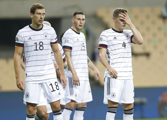 Germany's Leon Goretzka, Niklas Suele and Matthias Ginter, from left, react following the UEFA Nations League soccer match between Spain and Germany in Seville, Spain, Tuesday, Nov. 17, 2020. Spain won the match 6-0. (AP Photo/Miguel Morenatti)