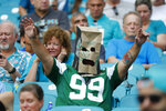 A New York Jets fan wears a paper bag after the team lost to the Miami Dolphins in an NFL football game, Sunday, Nov. 3, 2019, in Miami Gardens, Fla. (AP Photo/Wilfredo Lee)