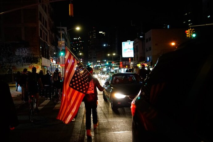 Demonstrators march in a protest, Wednesday, Sept. 23, 2020, in New York, following a Kentucky grand jury's decision not to indict any police officers for the killing of Breonna Taylor. (AP Photo/Eduardo Munoz Alvarez)