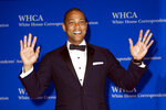 FILE - In this Saturday, April 29, 2017 file photo, CNN anchor Don Lemon waves as he arrives to the White House Correspondents' Dinner in Washington. On Friday, Nov. 9, 2018, The Associated Press has found that a photo circulating on the internet showing Lemon laughing during an apparent segment about Democrats burning flags on Election Day was fabricated. (AP Photo/Cliff Owen)