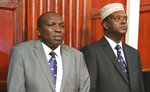 Former sports cabinet secretary Hassan Wario, right, and former director of administration Haron Komen sit in Milimani Court, Nairobi, Friday Oct. 19, 2018. Kip Keino, one of seven Kenyan Olympic and government officials accused, denied wrongdoing in the Kenyan Olympic corruption scandal in an interview with The Associated Press and didn't appear in court as expected Friday as prosecutors consider withdrawing charges against him and making him a witness over the alleged misuse of more than $545,000. (AP Photo/Brian Inganga)