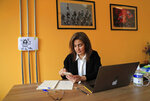 Diana Moukalled, a Lebanese journalist who closely follows social media checks the Clubhouse application, at her office in Beirut, Lebanon, Wednesday, April 7, 2021. Hundreds of thousands of people in the Arab world are turning to Clubhouse, the fast-growing audio chat app, to mock and vent against longtime rulers, and debate sensitive issues from abortion to sexual harassment. But concerns are mounting that the open space could quickly come under the same government surveillance or censorship as other social media. (AP Photo/Hussein Malla)