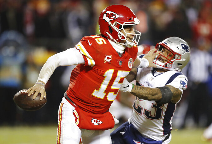New England Patriots strong safety Patrick Chung (23) pressures Kansas City Chiefs quarterback Patrick Mahomes during the second half of the AFC Championship NFL football game, Sunday, Jan. 20, 2019, in Kansas City, Mo. (AP Photo/Charlie Neibergall)
