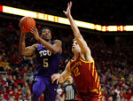 TCU guard Jaire Grayer, left, drives to the basket past Iowa State forward Michael Jacobson during the second half of an NCAA college basketball game, Tuesday, Feb. 25, 2020, in Ames, Iowa. Iowa State won 65-59. (AP Photo/Matthew Putney)