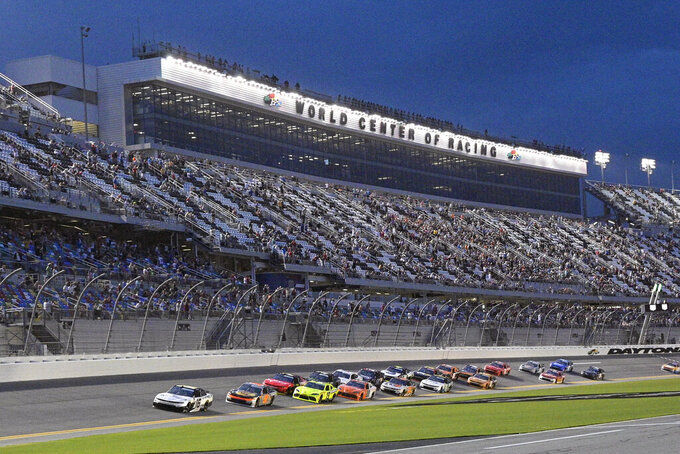AJ Allmendinger, left, and Noah Gragson, second from left, lead the field to start the NASCAR Xfinity Series auto race at Daytona International Speedway, Friday, Aug. 27, 2021, in Daytona Beach, Fla. (AP Photo/Phelan M. Ebenhack)