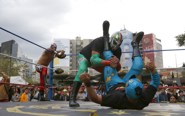 Mexican wrestler Rakner clashes with Relampago Veloz during