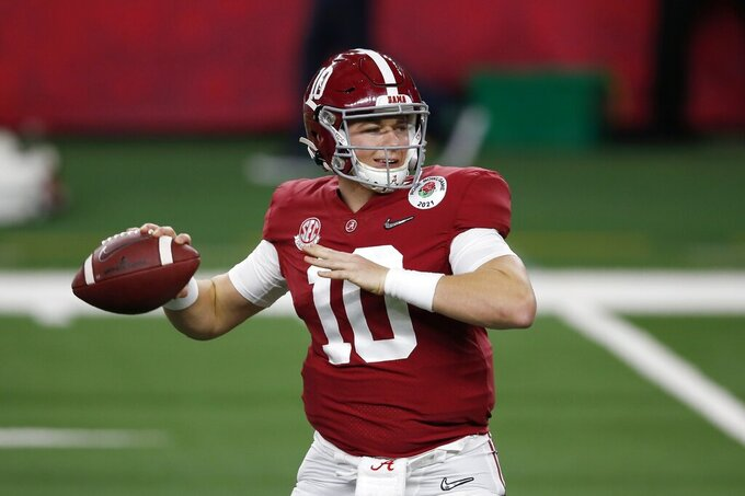 Alabama quarterback Mac Jones (10) warms up before the start of their Rose Bowl NCAA college football game against Notre Dame in Arlington, Texas, Friday, Jan. 1, 2021. (AP Photo/Roger Steinman)
