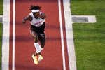 Will Claye competes during the prelims of men's triple jump at the U.S. Olympic Track and Field Trials Saturday, June 19, 2021, in Eugene, Ore. (AP Photo/Charlie Riedel)