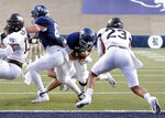 Rice quarterback Wiley Green, center, tries to dive behind tight end Jaeger Bull (82) who blocks Wake Forest defensive lineman Manny Walker (13) as linebacker Justin Strnad (23) blocks the route by Green, injuring him on a tackle, during the first half of an NCAA college football game Friday, Sept. 6, 2019, in Houston. Play was stopped as Green was attended to and was carted off the field. (AP Photo/Michael Wyke)