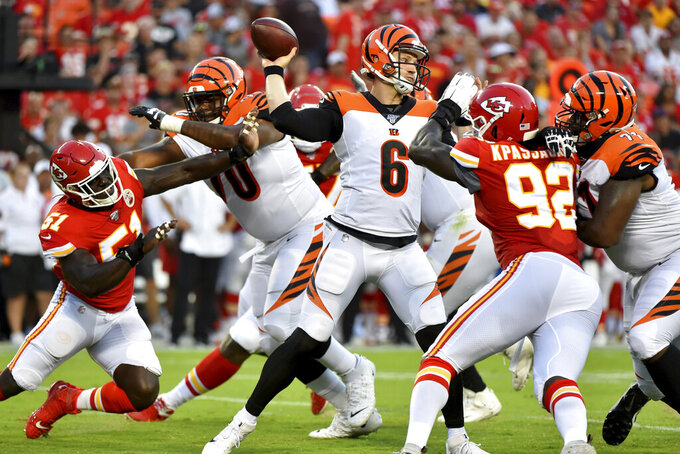 Cincinnati Bengals quarterback Jeff Driskel (6) throws under pressure from Kansas City Chiefs linebacker Tanoh Kpassagnon (92) during the first half of an NFL preseason football game in Kansas City, Mo., Saturday, Aug. 10, 2019. (AP Photo/Ed Zurga)