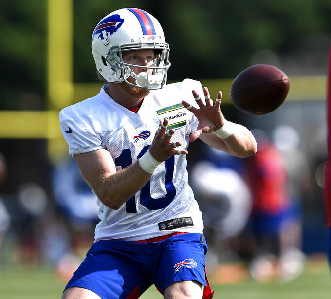 FILE - In this Thursday, July 25, 2019 file photo, Buffalo Bills wide receiver Cole Beasley catches a pass during practice at the NFL football team's training camp in Pittsford, N.Y. Buffalo's roster features a collection of draft picks, including quarterback Josh Allen and middle linebacker Tremaine Edmunds, each entering their second seasons. And the foundation has been supported by this past offseason's free-agency haul of about 20 additions _ a majority brought in to improve a patchwork offense and spur Allen's development. (AP Photo/Adrian Kraus, File)