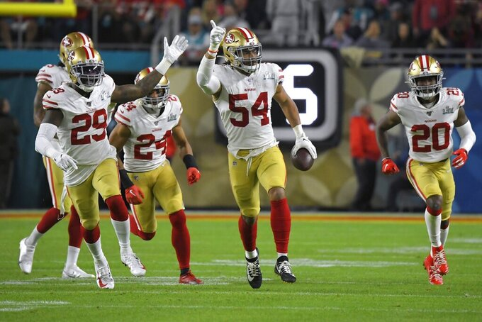 San Francisco 49ers' Fred Warner, center, celebrates his interception against the Kansas City Chiefs during the second half of the NFL Super Bowl 54 football game Sunday, Feb. 2, 2020, in Miami Gardens, Fla. (AP Photo/Mark J. Terrill)