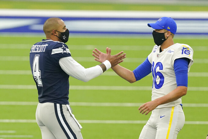 Dallas Cowboys quarterback Dak Prescott (4) shakes hands with Los Angeles Rams quarterback Jared Goff (16) before the start of an NFL football game Sunday, Sept. 13, 2020, in Inglewood, Calif. (AP Photo/Ashley Landis)