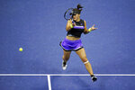 Bianca Andreescu, of Canada, returns a shot to Belinda Bencic, of Switzerland, during the semifinals of the U.S. Open tennis championships Thursday, Sept. 5, 2019, in New York. (AP Photo/Seth Wenig)