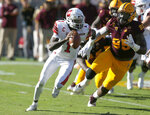 Utah quarterback Tyler Huntley (1) gets pressured by Arizona State defensive lineman Renell Wren in the second half during an NCAA college football game, Saturday, Nov. 3, 2018, in Tempe, Ariz. (AP Photo/Rick Scuteri)