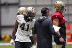 New Orleans Saints running back Alvin Kamara (41) talks to offensive coordinator Pete Carmichael during practice at their NFL football training facility in Metairie, La., Wednesday, Sept. 2, 2020. (AP Photo/Gerald Herbert, Pool)