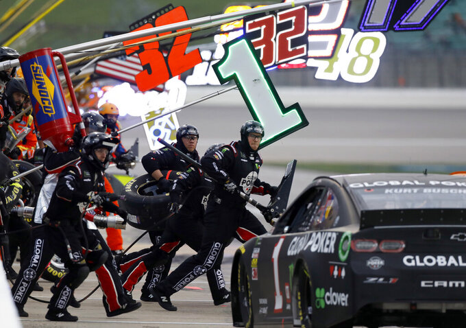Kurt Busch (1) pits during a NASCAR Cup Series auto race at Kansas Speedway in Kansas City, Kan., Saturday, May 11, 2019. (AP Photo/Colin E. Braley)