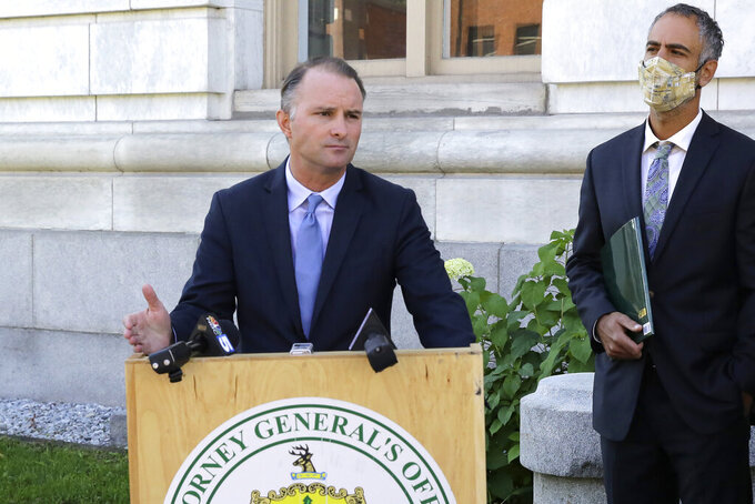 Vermont Attorney General T.J. Donovan, left, speaks in front of the Chittenden County Courthouse, in Burlington, Vt., Tuesday, Sept. 14, 2021, as he announces the state had filed a lawsuit against four fossil fuel companies alleging they misled the public about the impact their products have on climate change. Donovan says the state would like the companies to put warning labels on their products in much the same way tobacco products carry warning labels. (AP Photo/Wilson Ring)
