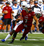 Troy quarterback Kaleb Barker (7) scrambles as he carries the ball against Boise State during the first half of an NCAA college football game, Saturday, Sept. 1, 2018, in Troy, Ala. (AP Photo/Butch Dill)