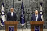 Israeli President Reuven Rivlin, right, and Blue and White Party leader Benny Gantz speak to media after Gantz receive a mandate to form new government to n Jerusalem, Wednesday, Oct. 23, 2019. (AP Photo/Sebastian Scheiner)