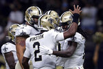 New Orleans Saints quarterback Jameis Winston (2) celebrates his touchdown pass with wide receiver Marquez Callaway (1), who caught the pass, in the first half of an NFL preseason football game against the Jacksonville Jaguars in New Orleans, Monday, Aug. 23, 2021. (AP Photo/Brett Duke)