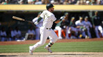 Oakland Athletics' Robbie Grossman swings for a two-run triple off Los Angeles Angels' Adalberto Mejia in the seventh inning of a baseball game Thursday, Sept. 5, 2019, in Oakland, Calif. (AP Photo/Ben Margot)