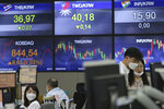 Currency traders watch monitors at the foreign exchange dealing room of the KEB Hana Bank headquarters in Seoul, South Korea, Tuesday, Sept. 29, 2020. Asian stocks were mixed Tuesday after Wall Street recovered some of this month's losses as investors looked ahead to a debate between President Donald Trump and his challenger in the November election, former Vice President Joe Biden. (AP Photo/Ahn Young-joon)