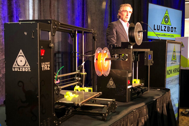 North Dakota Gov. Doug Burgum announced on Wednesday, Dec. 18, 2019 IN Fargo, N.D., that a popular but cash-poor 3D printer business in Colorado is relocating to North Dakota. Burgum said the LulzBot brand of 3D printers, left, will be manufactured by Fargo Additive Manufacturing Equipment 3D, or FAME 3D. The company plans to bring 13 employees from Colorado and hire an additional 50 workers. (AP Photo/David Kolpack)