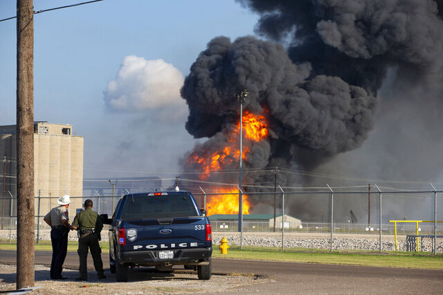 FILE - In this Friday, Aug. 21, 2020, file photo, emergency crews respond to a pipeline explosion near Lantana and Up River Road in Corpus Christi, Texas. The U.S. Coast Guard says the bodies of the remaining two crew members of a dredging boat who were missing after the explosion were found Monday, Aug. 24. (Courtney Sacco/Corpus Christi Caller-Times via AP, File)