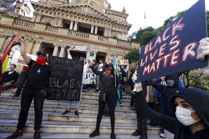 FILE - In this June 6, 2020, file photo, protesters gather at Town Hall in Sydney, to support the cause of U.S. protests over the death of George Floyd. Black Lives Matter has gone mainstream — and black activists are carefully assessing how they should respond. (AP Photo/Rick Rycroft, File)