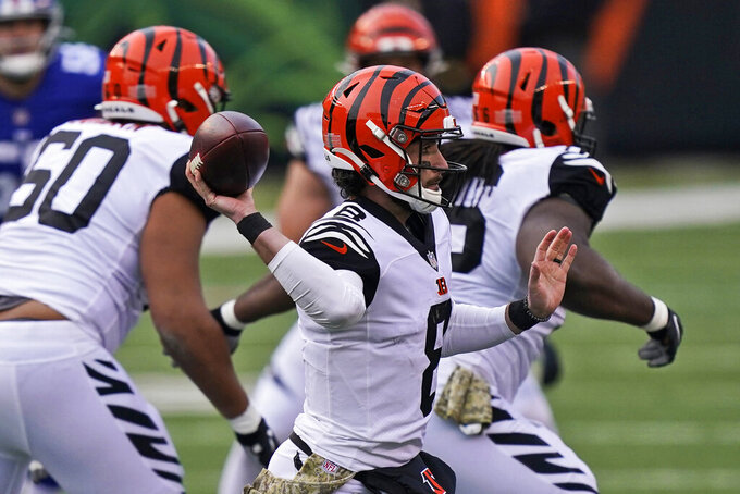 Cincinnati Bengals quarterback Brandon Allen passes during the second half of an NFL football game against the New York Giants, Sunday, Nov. 29, 2020, in Cincinnati. (AP Photo/Bryan Woolston)