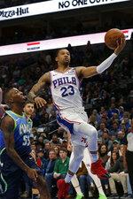Philadelphia 76ers guard Trey Burke (23) makes a layup in front of Dallas Mavericks guard Delon Wright (55) during the first half of an NBA basketball game in Dallas, Saturday, Jan 11, 2020. (AP Photo/Michael Ainsworth)