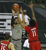 Baylor guard MaCio Teague (31) shoots a three-point basket past Texas Tech guard Kyler Edwards (11) in the second half of an NCAA college basketball game Sunday, March 7, 2021, in Waco, Texas. (AP Photo/Jerry Larson)