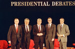 """FILE - In this Sunday, Feb. 14, 1988, file photo, Republican presidential candidates, Vice President George Bush, from left, Pat Robertson, Rep. Jack Kemp, Pierre """"Pete"""" du Pont and Senator Bob Dole pose before starting their last debate before the primary in Goffstown, N.H. Pierre S. """"Pete"""" du Pont IV, a former Delaware governor and congressman who sought the 1988 Republican presidential nomination, has died at age 86. Du Pont, a scion of the family that established the DuPont Co., died at his home in Wilmington, Del., on Saturday, May 8, 2021, after a long illness, his former chief of staff, Bob Perkins, said. (AP Photo/Jim Cole, File)"""
